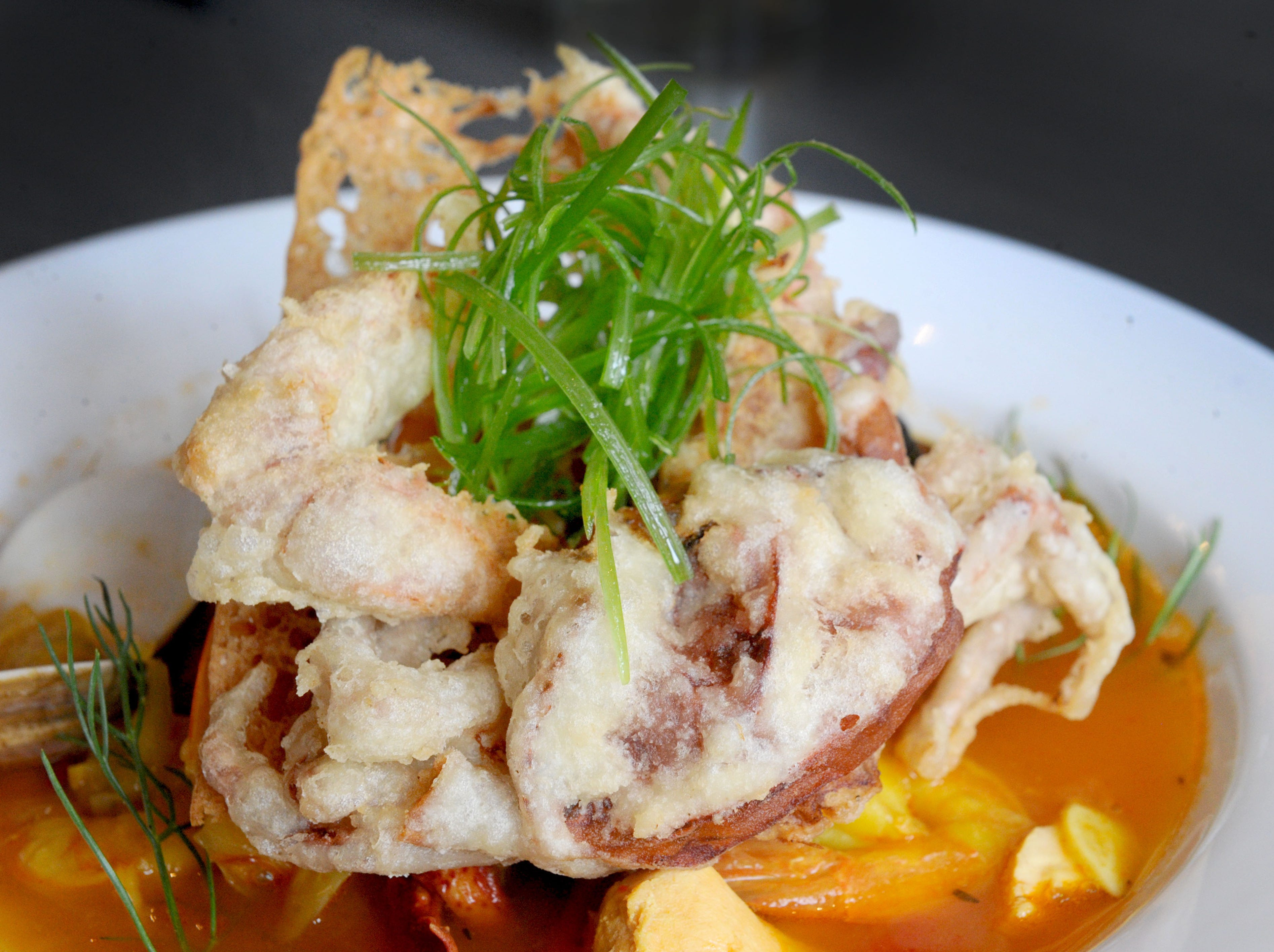 The fresh soft shell crab with seafood medley is prepared at Slate Bistro & Craft Bar in Camarillo.