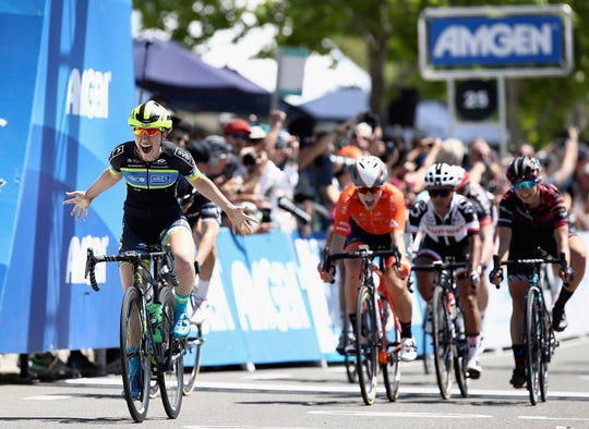 Kendall Ryan, of Ventura, celebrates as she wins the first stage of the 2018 Women's Tour of California in Elk Grove.  She and sister Alexis Ryan will ride in the tour Thursday in Ventura.