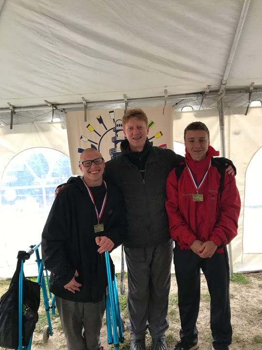 Joe Dietterick (left to right), coach Paul Myers and Jason Wheeler earned gold in the adaptive double event.