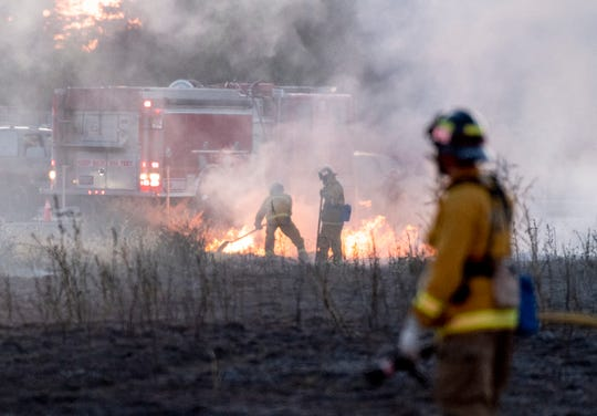 Tulare City Fire, Tulare County Fire and Visalia Fire departments joined to extinguish a grass fire just north of the Tulare Outlet Center on Monday, May 13, 2019.