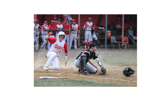 North Rockland's Jack Wren slides into home play during a 6-5 against Fox Lane at North Rockland High School on March 29, 2019.