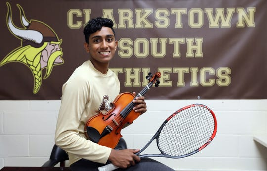 Scholar-Athlete Jonathan Abraham, 18, of Clarkstown South is the captain of the tennis team and plays six instruments. Abraham holds his violin and racquet at the high school in West Nyack May 14, 2019.