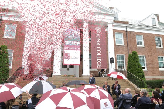 Confetti rains down at a ceremony for the renaming of Iona College's School of Business after Board of Trustee member and Iona alumnus, Robert V. LaPenta, on Sept. 12, 2018.