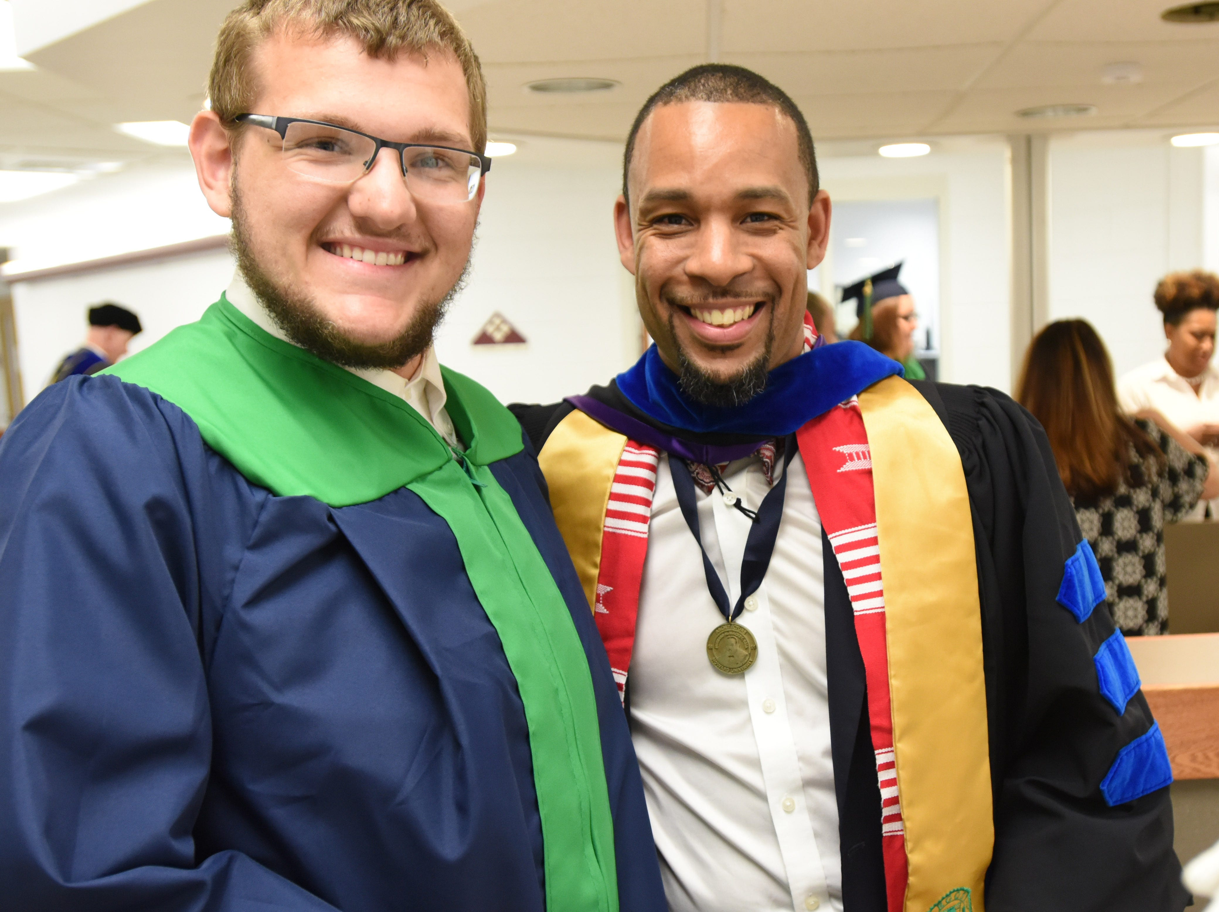 Delaware Technical Community College student Adam Faulkner of Hartly and professor R.S. Chandler get ready for commencement in Dover on Monday.