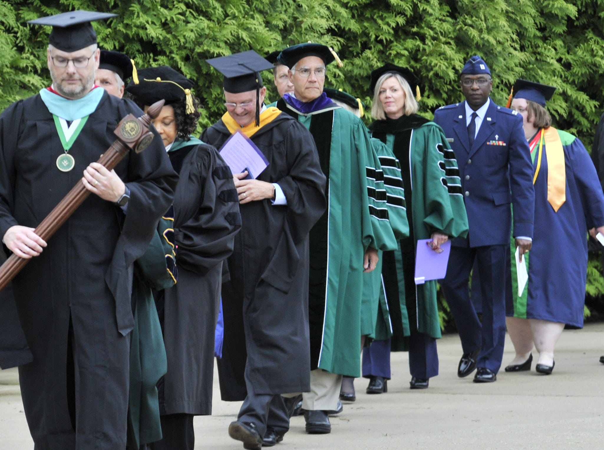 Procession from the main building to huge tent outside for Monday night's DelTech Terry Campus commencement.