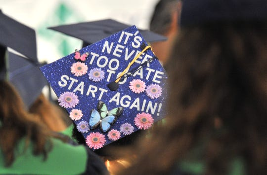 Decorated mortar boards scattered throughout the DelTech commencement exercise.