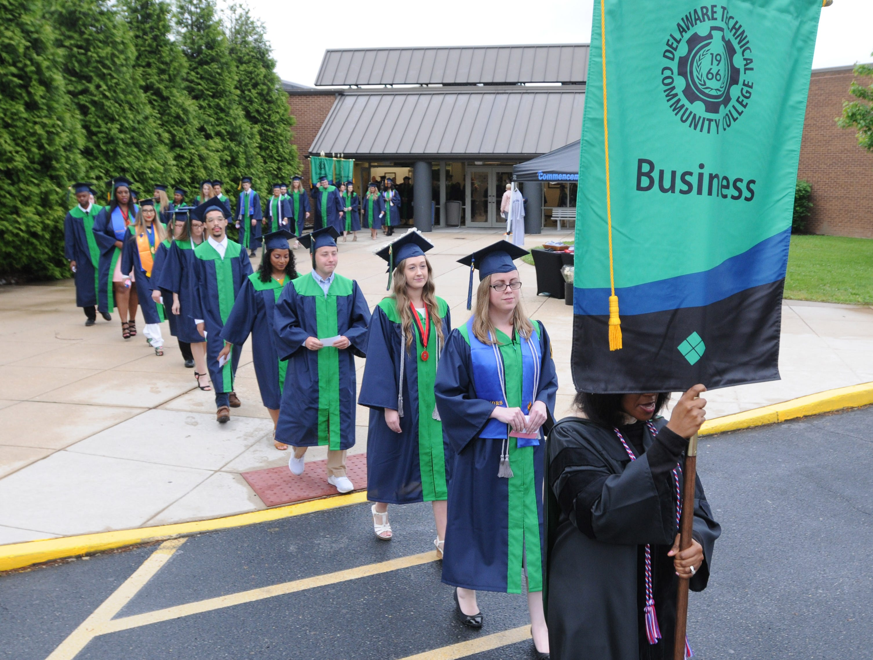 Delaware Technical Community College graduating seniors march in the procession for Monday night's commencement exercise on the Terry Campus in Dover.