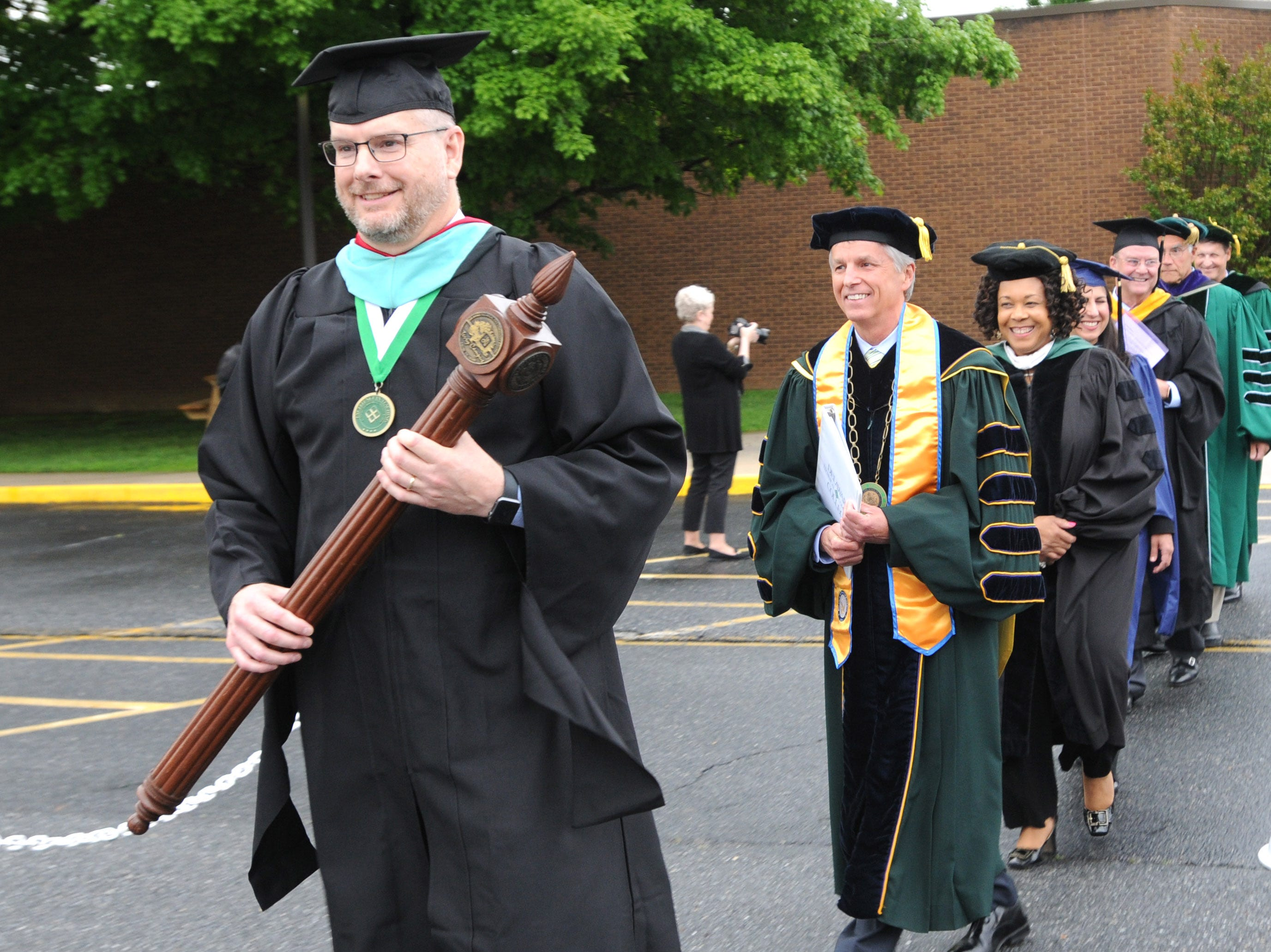 DelTech Terry Campus staff members leading the procession for Monday night's commencement exercise.