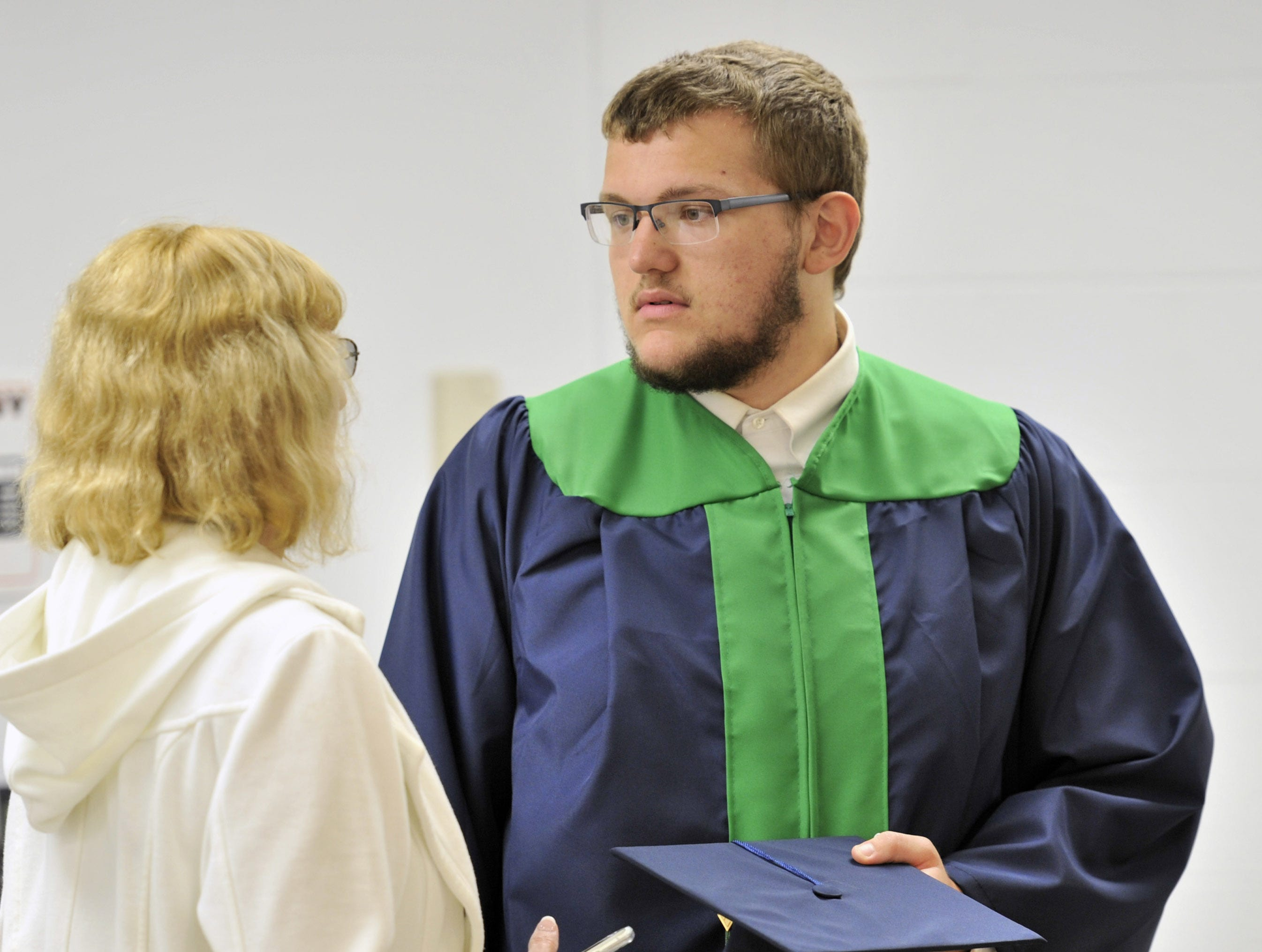Adam Faulkner, of Hartly, getting ready for DelTech's commencement exercise Monday night.