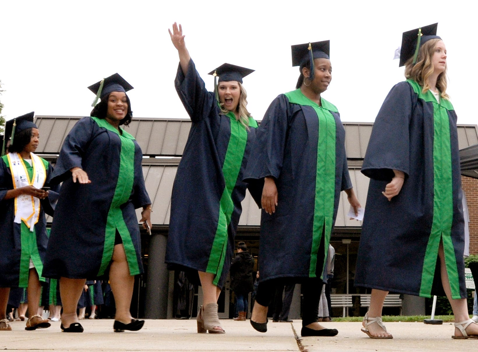 DelTech Terry campus graduating seniors march in the procession for Monday night's commencement exercise.