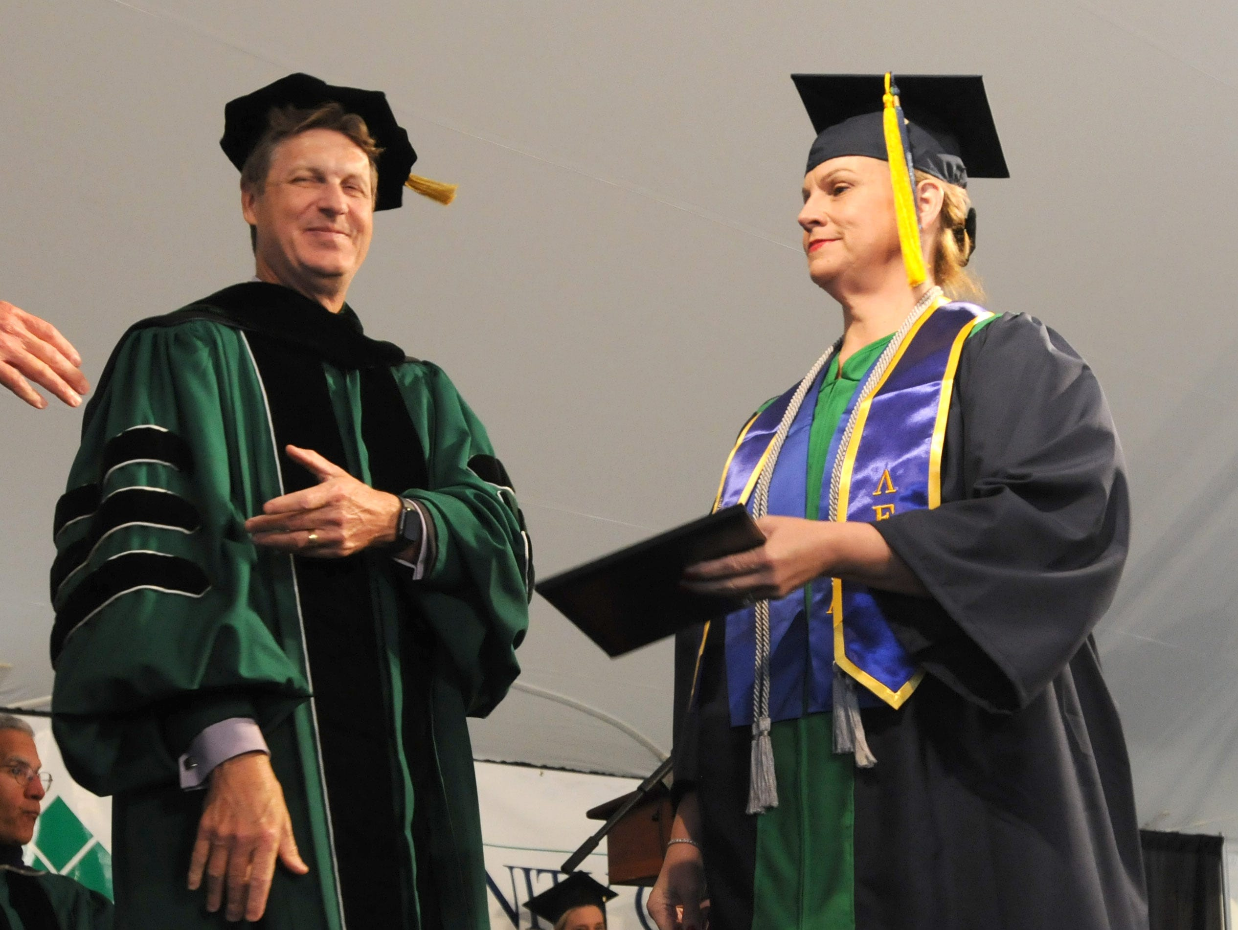 DelTech Terry campus graduates receiving their diplomas Monday night.