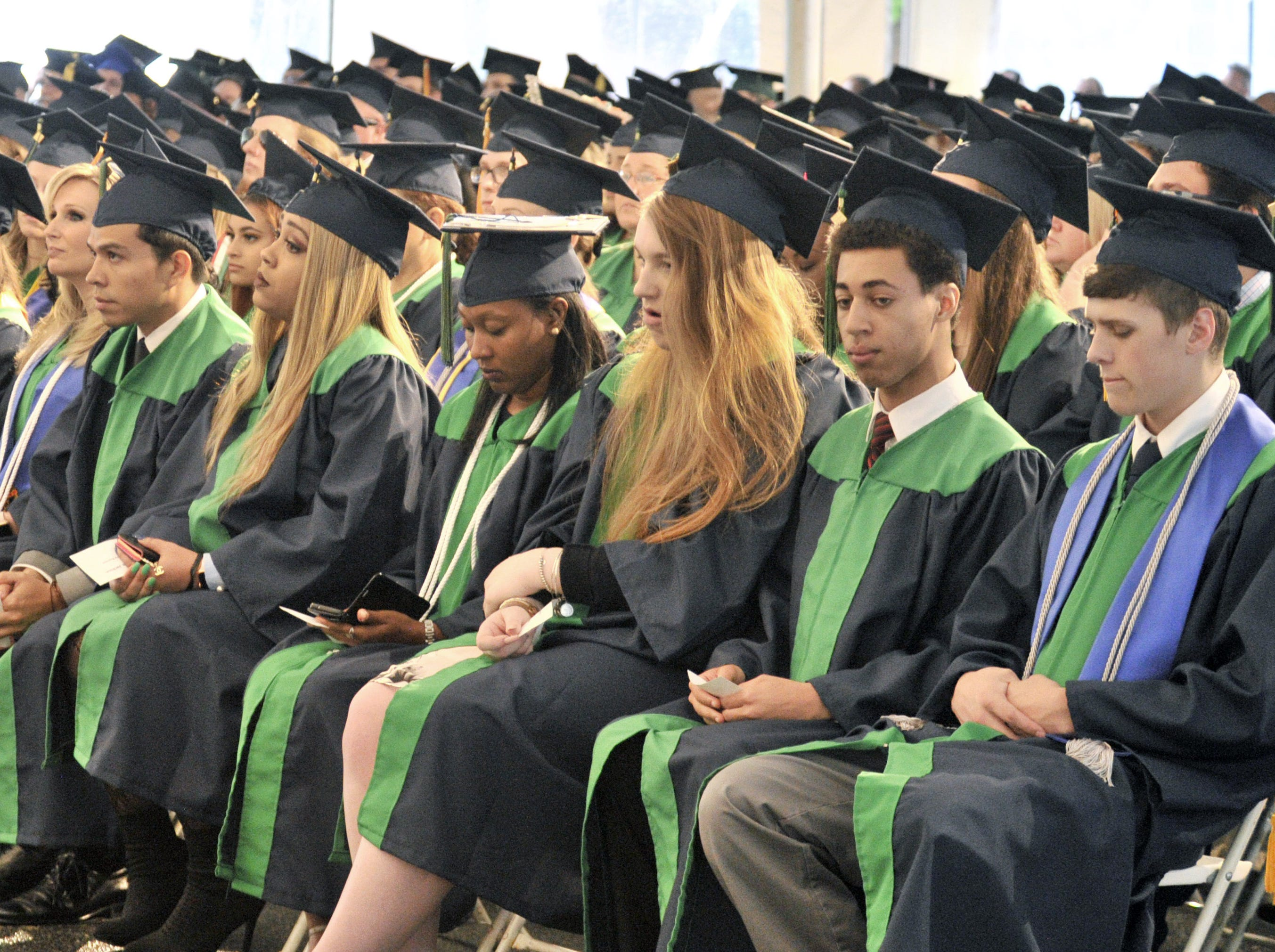 DelTech students waiting to get their degrees and diplomas during Monday night's commencement exercise.