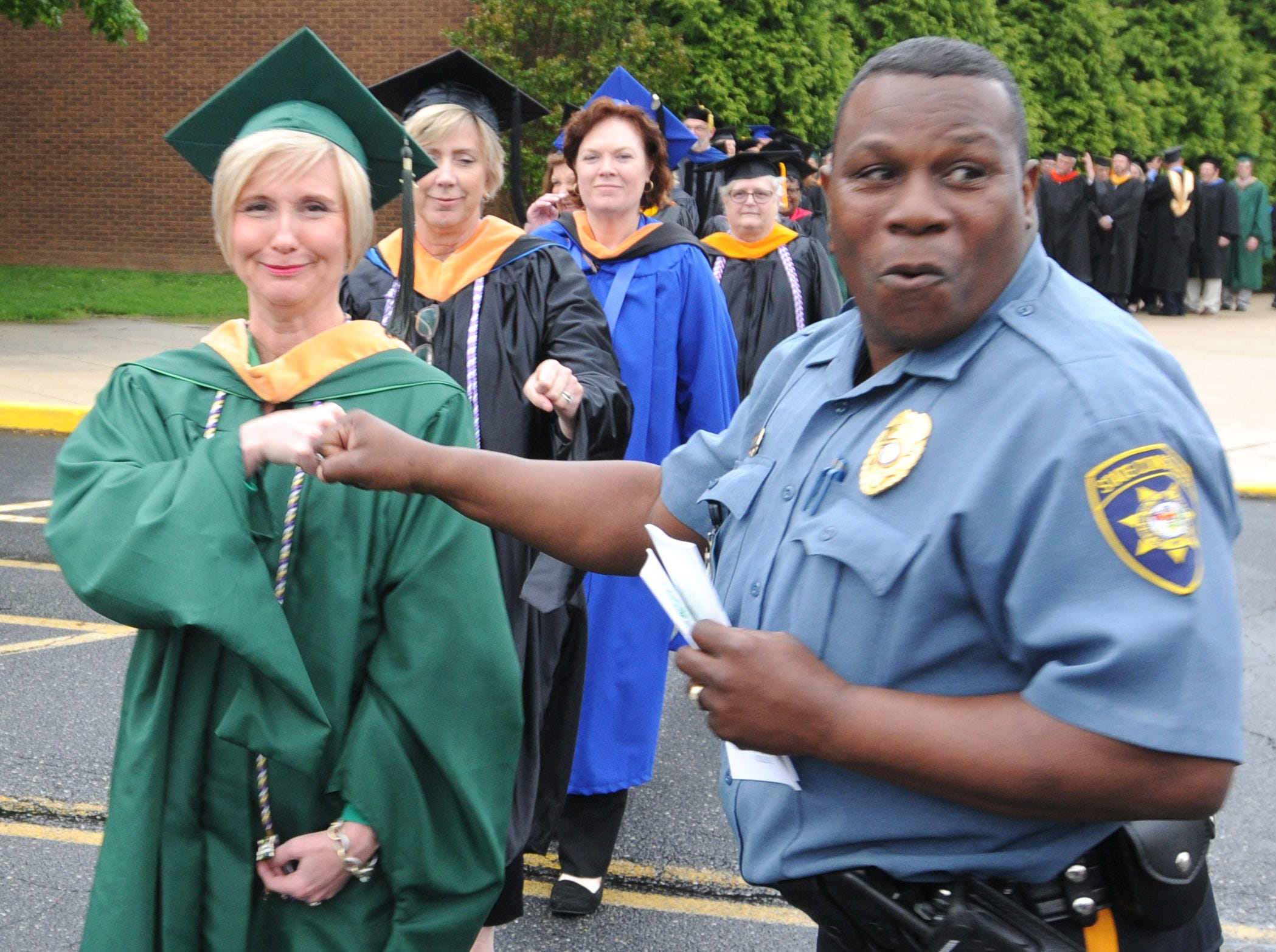 DelTech Terry Campus constable Mike Snead greeting students in the procession.