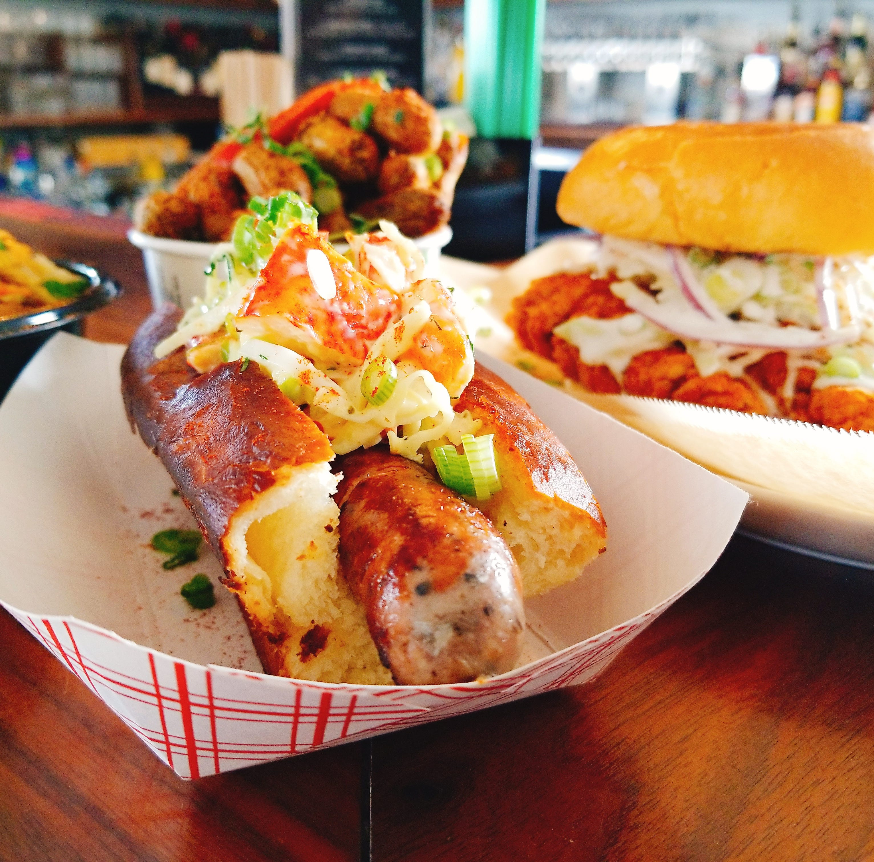 Scrapple hot dogs topped with lobster? Get one while you can