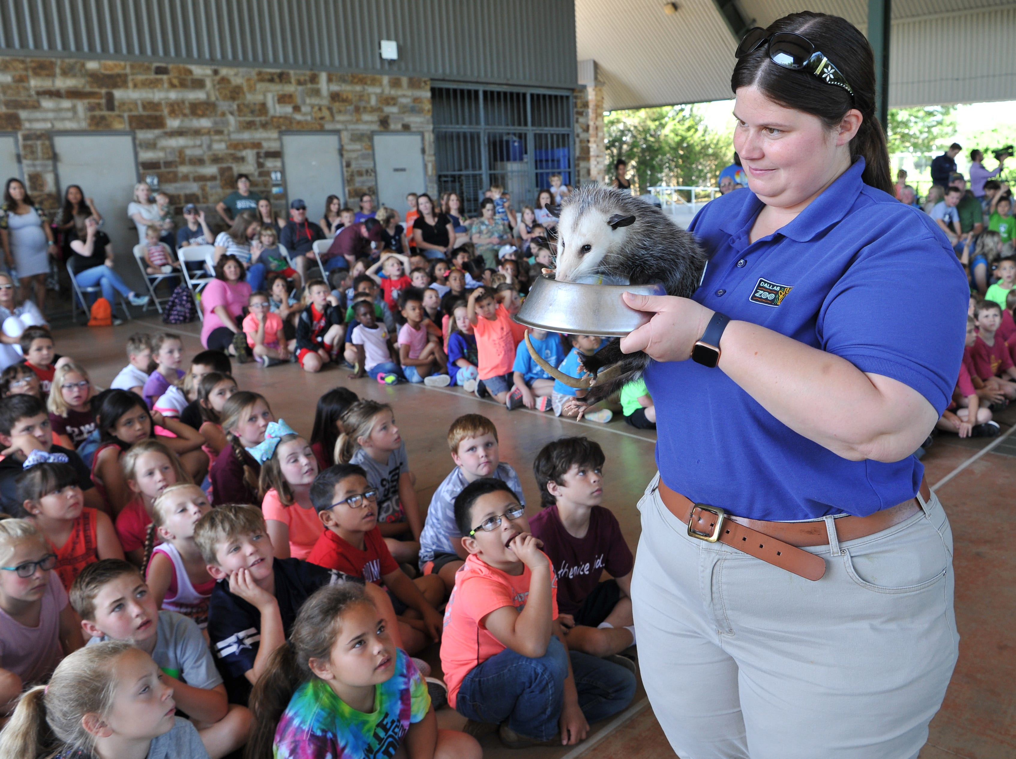 Dallas Zoo outreach specialist manager, Allyssa Leslie shows Emory the Opossum during the zoo's annual trip to the Wichita Falls River Bend Nature Center, Tuesday morning.