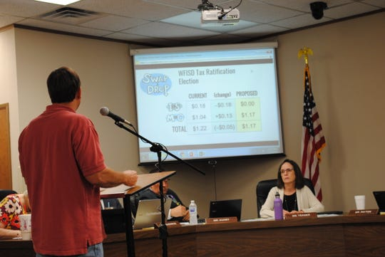 """Kevin Hunter speaks Tuesday during a WFISD public hearing concerning a possible """"swap and drop"""" change to the district's tax rate. The change would allow the district to gain $1.4 million in additional revenue with a lower tax rate."""