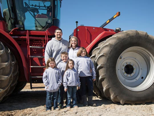 Brad and Kristi Walters enjoy raising their four children on the family operation, Walters Grain Farms.