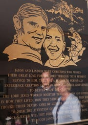 Chris and Kathy Cutshall are reflected in a photograph of a memorial plaque of their daughter Lindsay and soon-to-be son-in-law Jason Allen. The photograph hangs in Pastor Cutshall's office at Fresno Bible Church. The plaque is located at the  Rock-N-Water, a Christian summer camp near Coloma, California. Lindsay and Allen  were working at the camp in 2004 when they were fatally shot while sleeping on a beach.