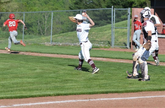 John Glenn pitcher Alex Kridelbaugh throws to first base in Tuesday's 1-0 loss to St. Clairsville in a Division II sectional final.