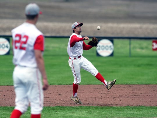 Nate Johnson watches as senior shortstop Reece Trowbridge throws out a runner at first base during Sheridan's 2-1 win against visiting Washington Court House on Monday in a Division II sectional win.