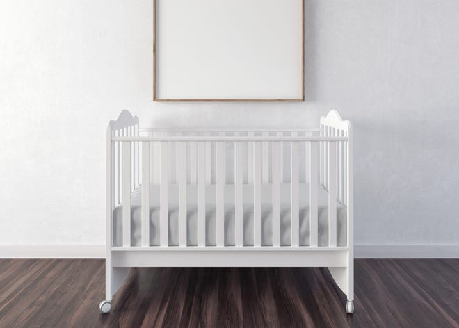 Stock photo of a basic baby crib. This is not one of the beds offered by the Safe Sleep Project.
