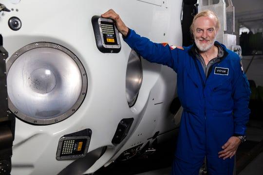 Explorer Victor Vescovo stands next to his deep ocean submersible.