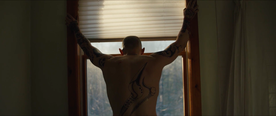 "Bryon (Jamie Bell) struggles to leave his far-right sect in ""Skin."""