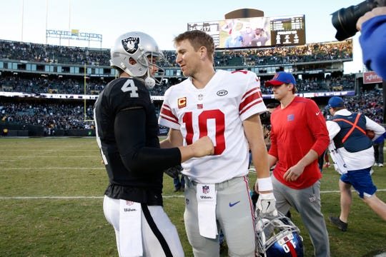 "Giants QB Eli Manning (10) and Raiders QB Derek Carr appear to be among 2019's ""Hard Knocks"" finalists."