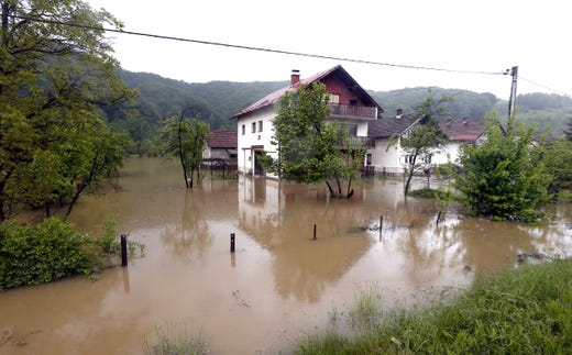 Floodwater flows in the Teslic town in Central Bosnia, Bosnia and Herzegovina after the region was hit by heavy rains.