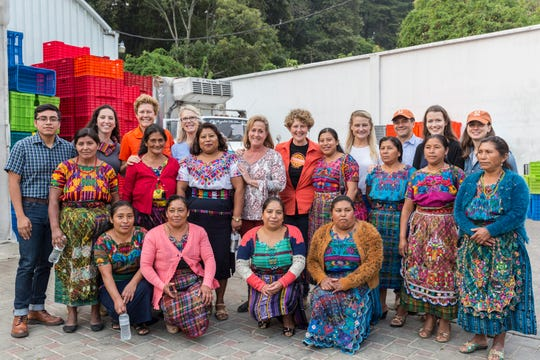 GOP Reps. Carol Miller (blue shirt), Ann Wagner (floral shirt) and Susan Brooks (orange blazer) with members of the Cuatro Pinos women's agricultural cooperative in San Lucas Sacatepéquez, Guatemala, on April 27, 2019.