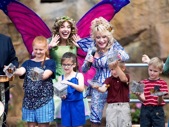 Dolly Parton helps children release butterflies during the grand opening of Dollywood's new Wildwood Grove expansion on Friday, May 10, 2019.
