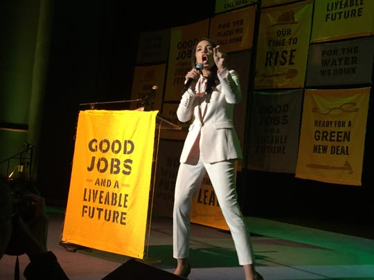 Rep. Alexandria Ocasio-Cortez, D-N.Y., responds to a crowd at Howard University Monday who gathered to cheer her Green New Deal.