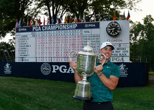 Brooks Koepka poses with the Wanamaker Trophy after winning the 2018 PGA Championship.