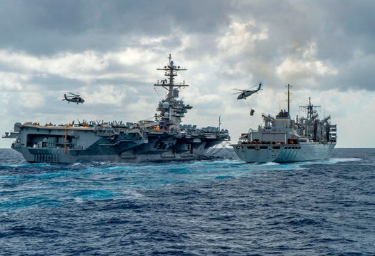 This handout picture released by the U.S. Navy on May 8, 2019, shows the Nimitz-class aircraft carrier USS Abraham Lincoln conducting exercises in the Persian Gulf.