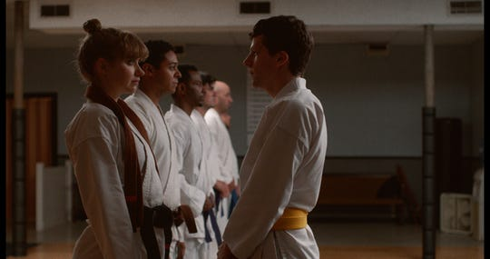 "Karate students Anna (Imogen Poots, left) and Casey (Jesse Eisenberg) become reluctant allies in ""The Art of Self-Defense."""