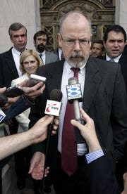 In this April 25, 2006, file photo, John Durham speaks to reporters on the steps of U.S. District Court in New Haven, Conn.