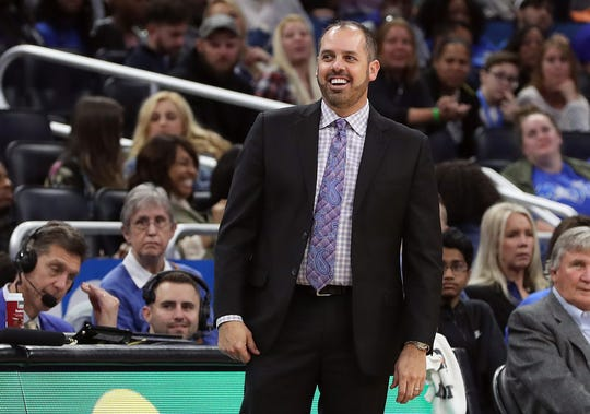 Former Orlando Magic head coach Frank Vogel smiles during a game against the Washington Wizards.