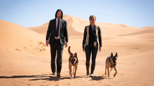 "John Wick (Keanu Reeves), Sofia (Halle Berry) and her battle-ready Malinois find heaps of trouble in the new action film ""John Wick: Chapter 3."""