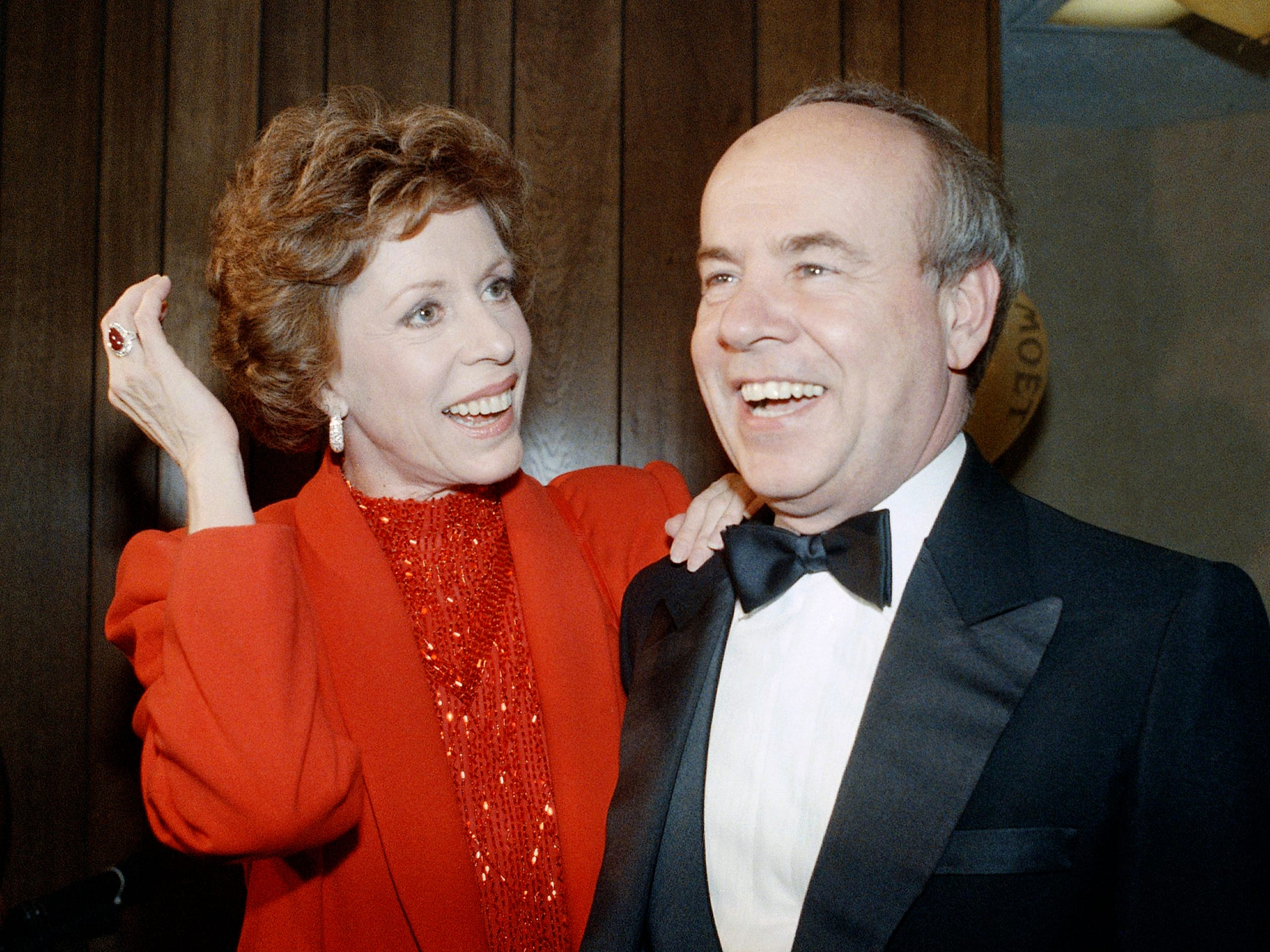 """In this April 26, 1986 file photo, Carol Burnett, left, and veteran comrade in comedy Tim Conway laugh during a gala birthday party for Burnett in Los Angeles.  Conway, the impish second banana to Burnett who won four Emmy Awards on her TV variety show, starred aboard """"McHale's Navy"""" and later created a very short character named Dorf, has died. He was 85. Conway died Tuesday morning, May 14, 2019,  in a Los Angeles care facility after a long illness, according to Howard Bragman, who heads LaBrea Media."""