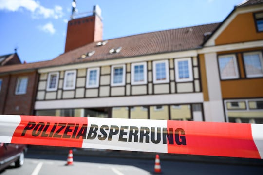 A house is cordoned off in Wittingen, northern Germany, where two bodies were found on May 13, 2019 during investigations into the deaths of three people discovered in a Bavarian hotel room and killed by crossbow bolts.