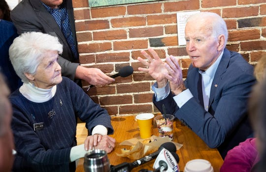 Former Vice President and Democratic candidate for United States President, Joe Biden (R) takes questions from reporters during a stop for coffee and a talk with local politicians at The Works in Concord, New Hampshire, USA, 14 May 2019. Biden is on a two day campaign tour of New Hampshire, the first since his announcing his 2020 campaign.  EPA-EFE/CJ GUNTHER ORG