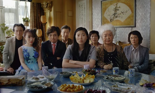 """Struggling writer Billi (Awkwafina, center) travels to China to say goodbye to her cancer-stricken grandmother in Lulu Wang's """"The Farewell."""""""