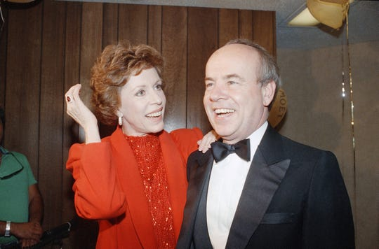 Carol Burnett and veteran comrade in comedy Tim Conway share yet another laugh during a gala birthday party for Burnett at night on Saturday, April 26, 1986 in Los Angeles at UCLA?s Pauley Pavilion. (AP Photo/Nick Ut)