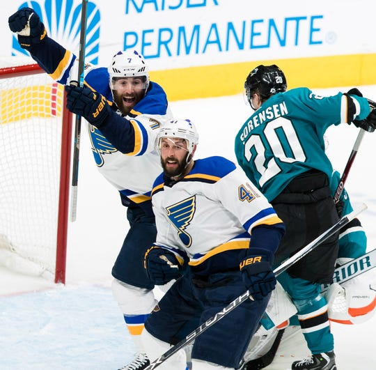 St. Louis Blues defenseman Robert Bortuzzo (41) celebrates with teammate Pat Maroon after scoring a goal against the San Jose Sharks.