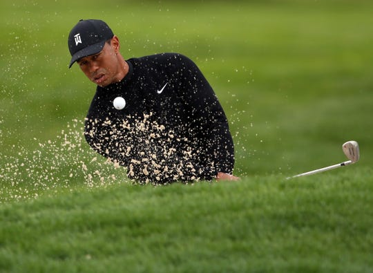 Tiger Woods practices for the PGA Championship at Bethpage Black.