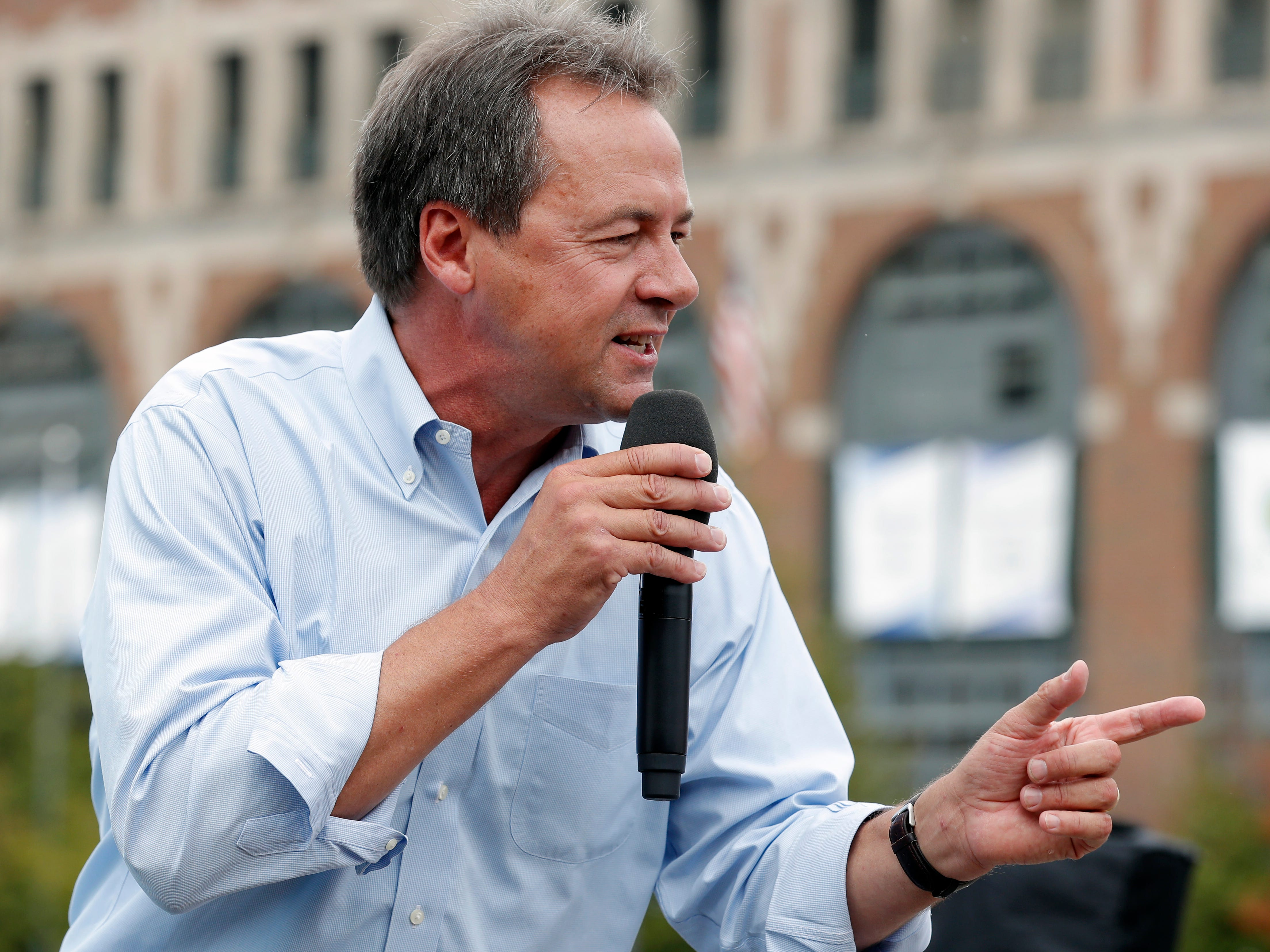 FILE - In this Aug. 16, 2018, file photo, Montana Gov. Steve Bullock speaks at the Des Moines Register Soapbox during a visit to the Iowa State Fair in Des Moines, Iowa. Motivated by an urgency to unseat President Donald Trump and the prospect of a historically large primary field, Democrats see little incentive to delay or downplay their 2020 presidential hopes. (AP Photo/Charlie Neibergall, File)