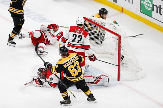 Hurricanes goaltender Petr Mrazek (34) reacts after giving up a goal to Bruins left wing Jake DeBrusk (74) during Game 2 of the Eastern Conference final.