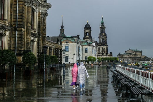Pedestrians walk over Bruehl's Terrace during a rainy day in Dresden, Germany. Meteorologists predict the rainy weather will continue in the next days in Germany's Saxony state.