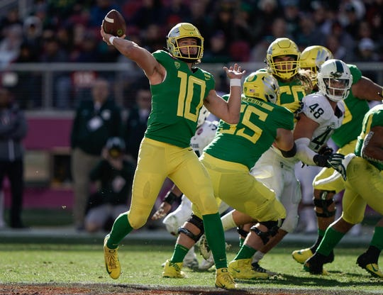 Oregon quarterback Justin Herbert prepares to throw against Michigan State during the 2018 Holiday Bowl.