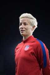 Megan Rapinoe is the first openly gay woman to be featured in an 'SI' swimsuit issue.